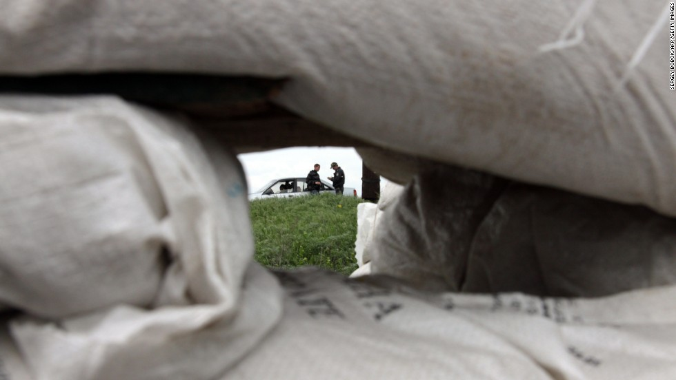 Ukrainian policemen check documents at a checkpoint near the northeastern city of Izium on May 5.