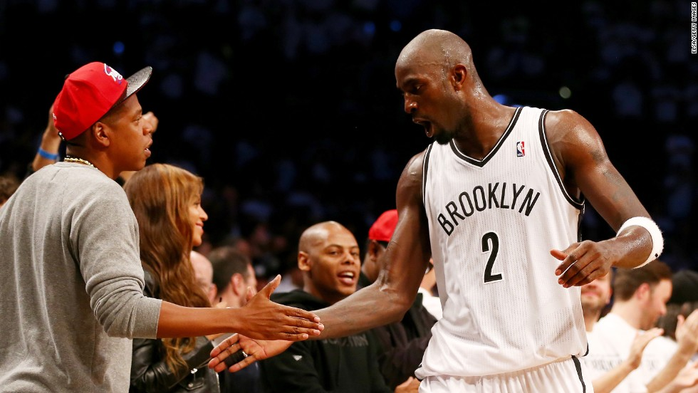 Kevin Garnett of the NBA's Brooklyn Nets is congratulated by rapper Jay-Z during Brooklyn's Game 6 playoff victory against Toronto on Friday, May 2. Brooklyn went on to win Game 7 in Toronto and advance to the Eastern Conference semifinals.