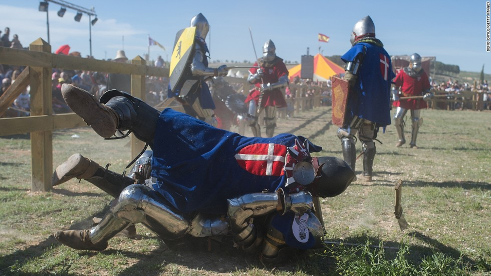 A knight of the Danish team falls on top of a knight from the Polish team during the International Medieval Combat event Thursday, May 1, in Belmonte, Spain. The contact sport uses blunt weapons and is based on the medieval tournaments of the 14th and 15th centuries.