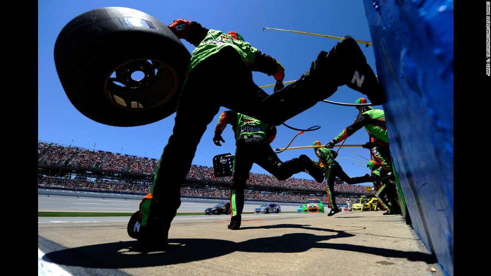 The pit crew of Danica Patrick jumps over the wall Sunday, May 4, during the NASCAR Sprint Cup race in Talladega, Alabama. Patrick finished 22nd in the race, which was won by Denny Hamlin.