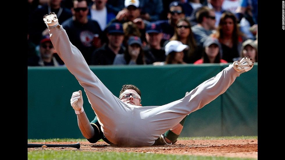 Oakland's Josh Donaldson lands on his back after a close pitch Sunday, May 4, during a Major League Baseball game in Boston. Oakland won the game 3-2.