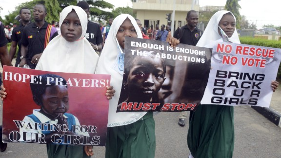 School pupils hold signs as members of Lagos based civil society groups hold rally calling for the release of missing Chibok school girls at the state government house, in Lagos, Nigeria, on May 5, 2014.