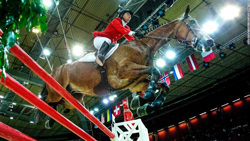 Beezie Madden of the U.S. and her horse Simon ride to glory at the FEI World Cup jumping final at the Gothenburg Horse Show in Sweden in April 2013.
