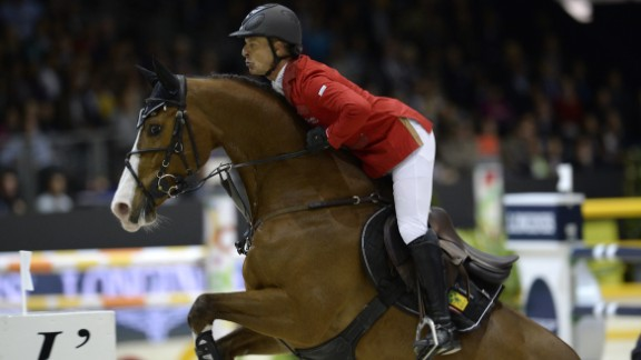 Schwizer competes on horse Toulago during the jumping final at the FEI World Cup jumping and dressage finals in Chassieu, France.