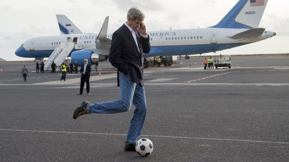 Kerry kicks around a soccer ball during an airplane refueling stop at Sal Island, Cape Verde, on Monday, May 5, 2014. Kerry was on his first major tour of Africa, focusing on some of the continent