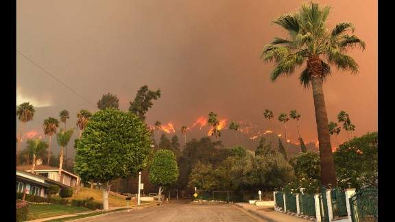 The report breaks the country down by region and identifies specific threats should climate change continue. Major concerns cited by scientists involved in creating the report include rising sea levels along America's coasts, drought in the Southwest and prolonged fire seasons. In this image from January 16, a wildfire burns in the hills just north of the San Gabriel Valley community of Glendora, California.