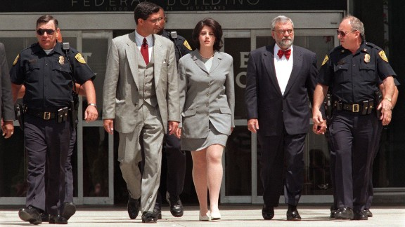 Lewinsky is escorted by police officers, federal investigators and attorney William Ginsburg, second right, as she leaves the Federal Building in Westwood, California, in 1998. She was there submitting evidence on her relationship with Clinton, who was impeached by the House of Representatives on charges of perjury and obstruction of justice. He was later acquitted.