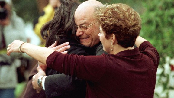 Lewinsky's father, Bernard, hugs her in front of his home in Brentwood, California, in 1998.