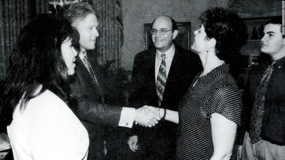 Lewinsky, far left, is seen with President Clinton at the White House.