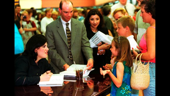"Lewinsky speaks with young fans as she signs copies of her autobiography, ""Monica's Story,"" in 1999."