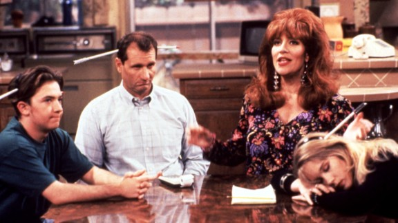 """Peggy Bundy of """"Married ... With Children"""" (Katey Sagal, second from right) was blowzy and materialistic, but she would stand with her family when threatened. Son Bud (David Faustino), husband Al (Ed O"""