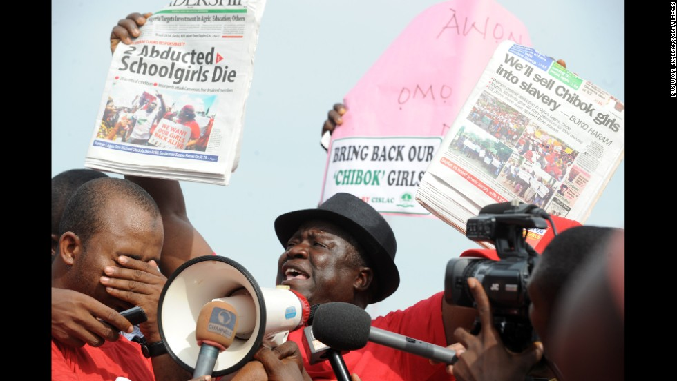 Community leader Hosea Sambido speaks during a May 6 rally in Abuja.
