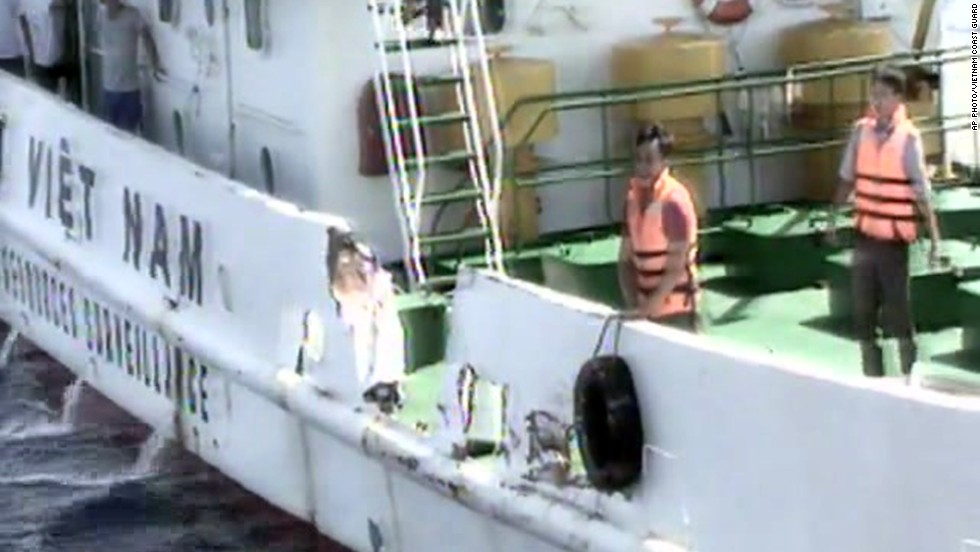 In this video image released by the Vietnam Coast Guard, Vietnamese surveillance ship crew members stand near the side of the ship, allegedly damaged after being rammed by a Chinese ship.