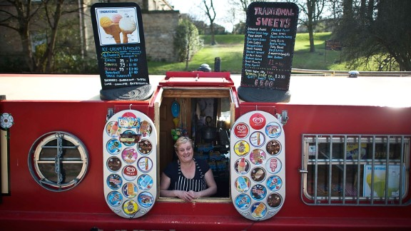 Narrowboats don't just offer a home, but a unique retail opportunity, as this British ice-cream vendor happily shows.
