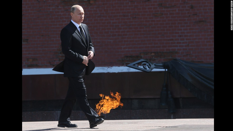 Russian President Vladimir Putin attends a wreath-laying ceremony at the Tomb of the Unknown Soldier in Moscow on Thursday, May 8. Russia celebrates Victory Day on May 9, which is when Nazi Germany surrendered to the Soviet Union during World War II.