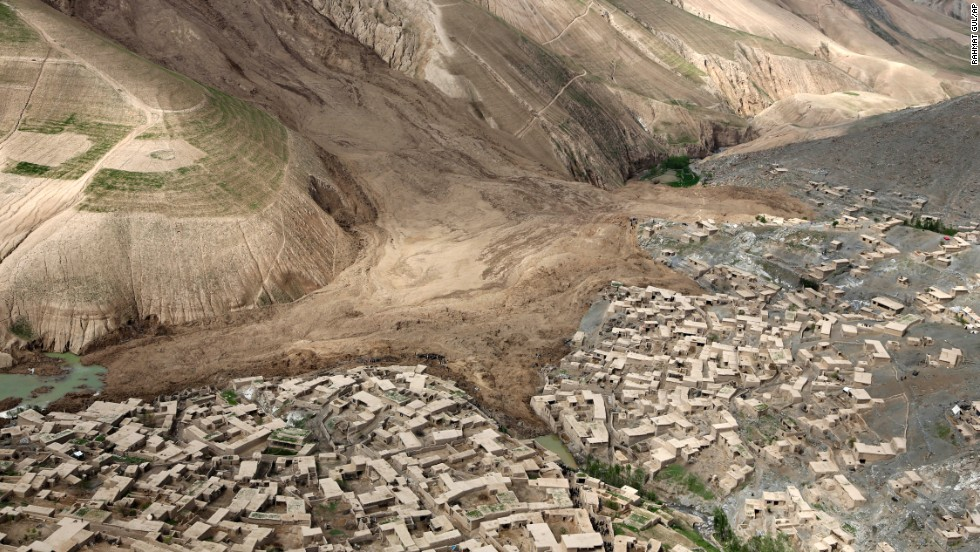 "An aerial view on Monday, May 5, shows the destruction of a <a href=""http://www.cnn.com/2014/05/03/world/gallery/afghan-landslide/index.html"">double landslide</a> that engulfed the village of Abi Barak in Afghanistan. More than 2,000 people were killed when a mass of rock and mud came crashing down on Friday, May 2."