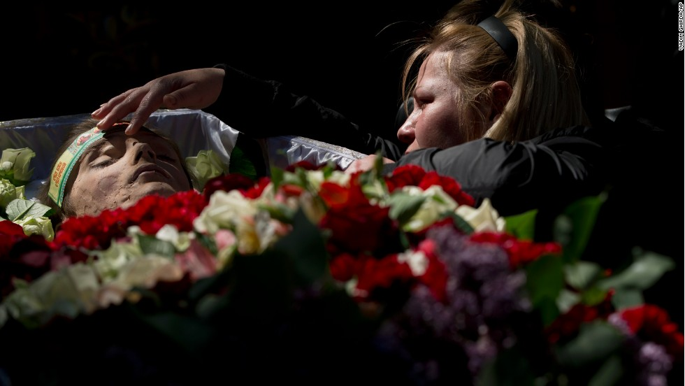"A relative mourns by the body of 17-year-old Vadim Papura during a service in Odessa, Ukraine, on Tuesday, May 6. Papura died after jumping out of a burning trade union building during riots on May 2. Unrest has been <a href=""http://www.cnn.com/2014/03/26/world/gallery/ukraine-crisis/index.html"">intensifying in Ukraine</a>, further raising fears of a civil war or invasion by Russia."