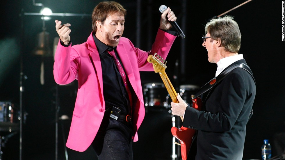 The origins of British instrumental group The Shadows date back to 1958, with Cliff Richard as a key front person. The band disbanded in 1968, but started up again in the 70s. They were then inactive through the 90s but reunited in the mid 2000s. Here, the now Sir Cliff Richard performs with Hank Marvin of The Shadows at Kirstenbosch Gardens to a sold out crowd on 9 March 2010 in Cape Town, South Africa.