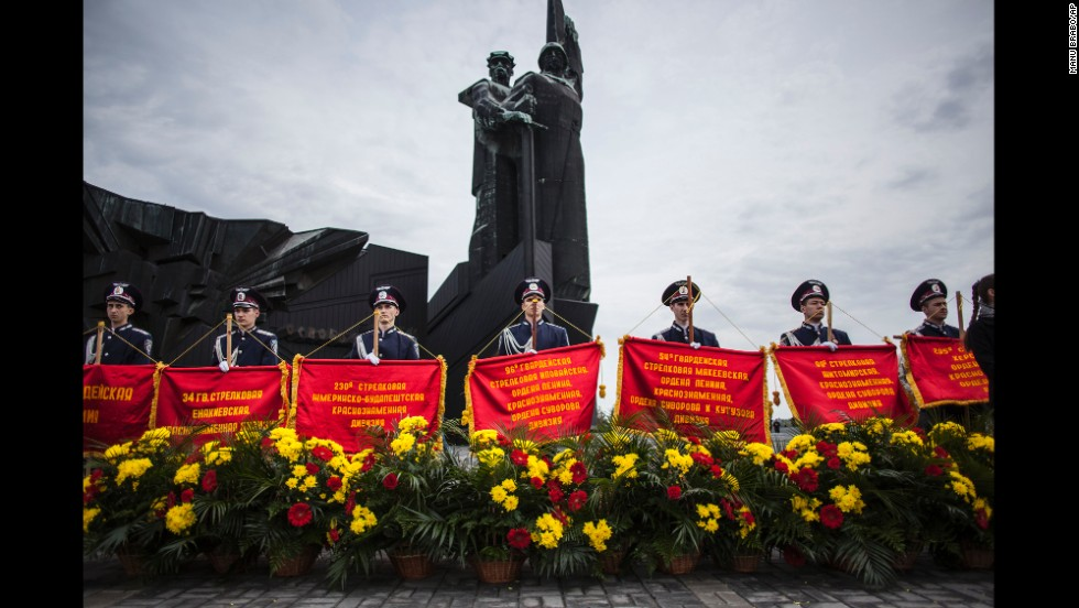 Ukrainian police officers stand behind banners during a ceremony in Donetsk, Ukraine.