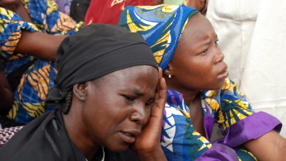 Mothers of the missing Chibok school girls abducted by Boko Haram Islamists gather to receive informations from officials on May 5, 2014. Nigeria