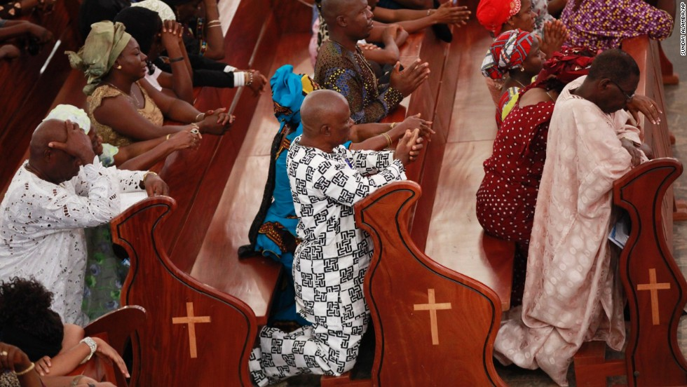 Catholic faithful attend a morning Mass in honor of the kidnapped schoolgirls in Abuja on May 11.