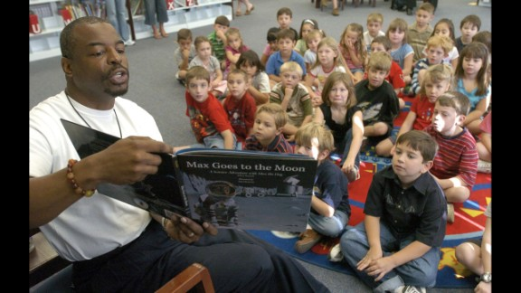Burton reads to elementary school students in Land O