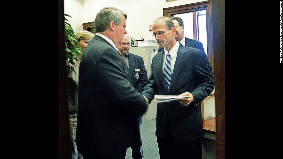 In May 2009, Maine state Sen. Dennis Damon, left, hands Gov.
