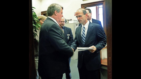 In May 2009, Maine state Sen. Dennis Damon, left, hands Gov. John Baldacci the bill that the state Senate passed to affirm the right of same-sex couples to marry.
