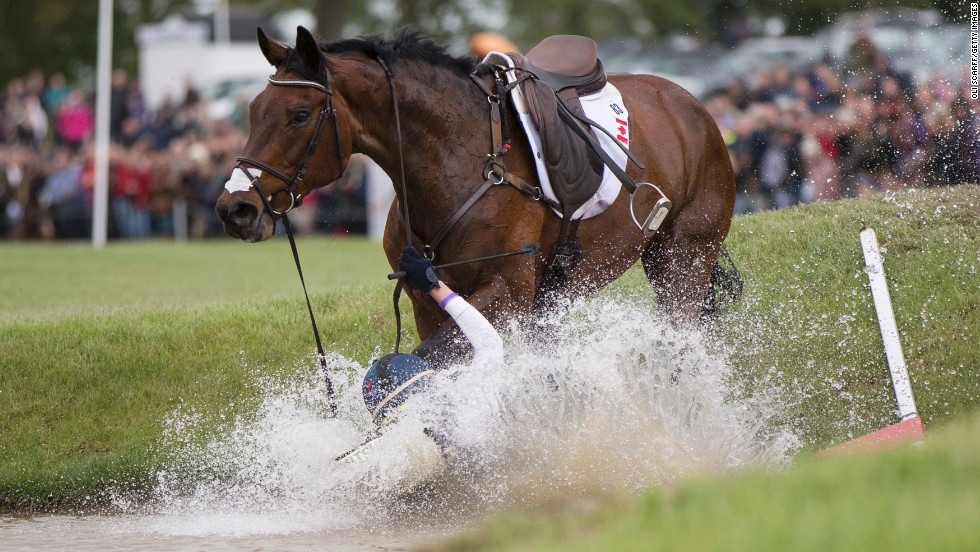 Canadian rider Rebecca Howard falls from her horse, Riddle Master, on the penultimate day of the Badminton Horse Trials on Saturday, May 10. The Badminton Horse Trials, which were first held in 1949, take place over six days on the Duke of Beaufort's Badminton Estate in England.