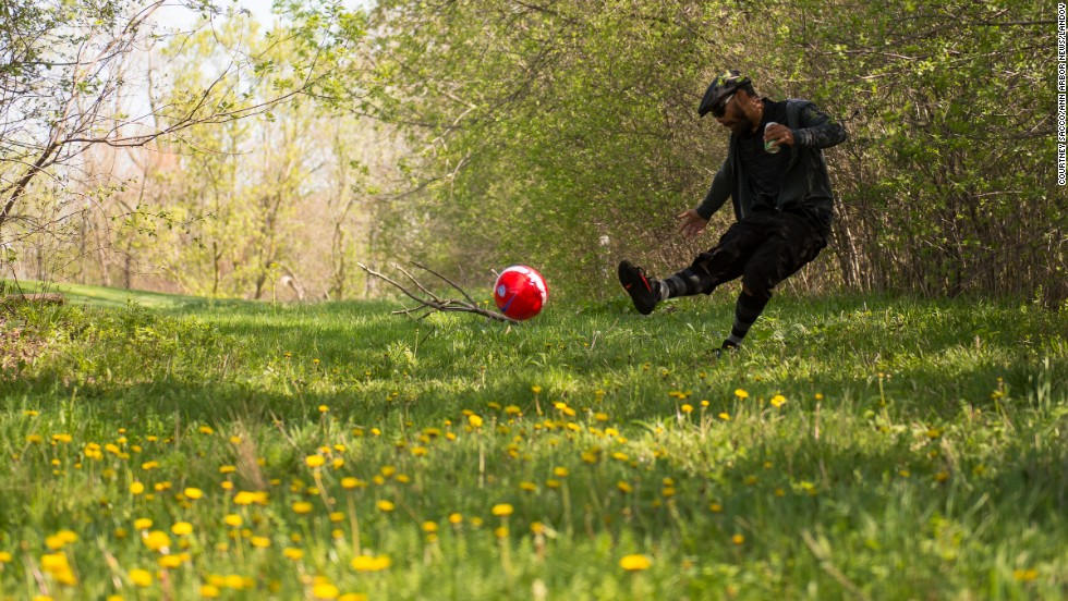 Sean Waiwaiole kicks his ball out of the rough on the 12th hole of the first ever FootGolf tournament, held at the Fox Hills Golf Course in Salem Township, Michigan, on Saturday, May 10.