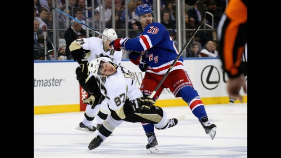Sidney Crosby #87 of the Pittsburgh Penguins is checked by Chris Kreider #20 of the New York Rangers during Game Four of the Second Round in the 2014 NHL Stanley Cup Playoffs at Madison Square Garden on May 7, 2014 in New York City.
