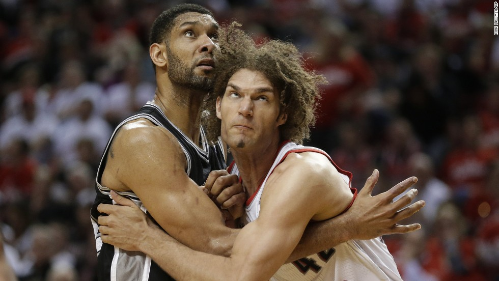 Portland Trail Blazers' Robin Lopez, right, and San Antonio Spurs' Tim Duncan battle under the boards during Game 3 of a conference semifinal playoff series in Portland, Oregon, on Saturday, May 10.