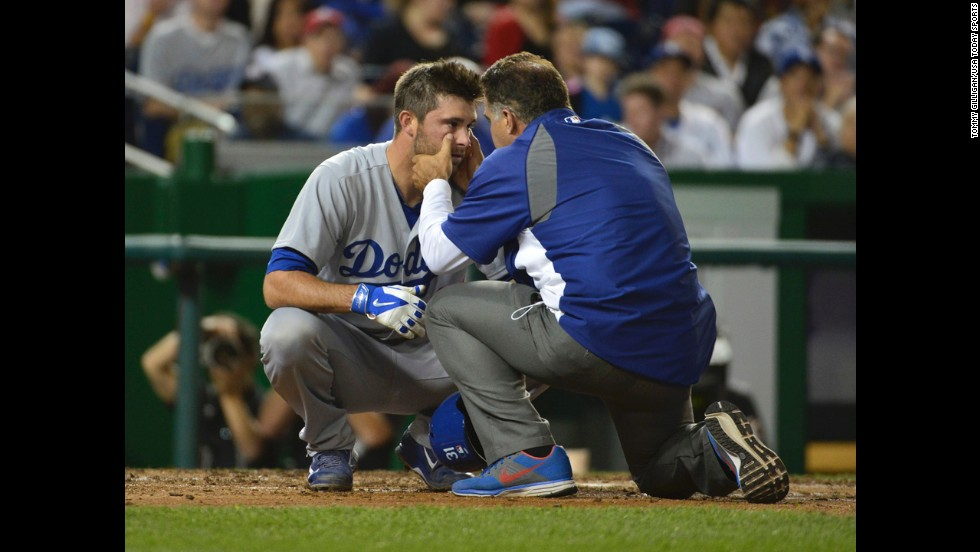 "Los Angeles Dodgers catcher Drew Butera is examined by director of medical services Stan Conte after being hit in the face by a foul ball during the seventh inning against the Washington Nationals at Nationals Park in Washington on Tuesday, May 6. The Dodgers won the game 8-3. <a href=""http://www.cnn.com/2014/05/06/worldsport/gallery/what-a-shot-0506/index.html"">See 41 amazing sports photos from last week</a>"
