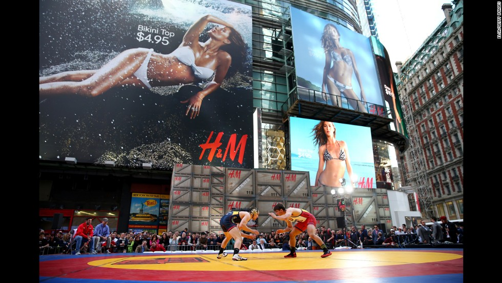 Wrestlers compete in the Beat the Streets Wrestling Exhibition at Times Square in New York on Wednesday, May 7.