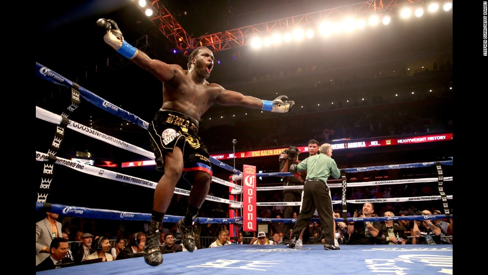 Bermane Stiverne celebrates as the referee holds Chris Arreola after stopping the WBC heavyweight championship match at Galen Center in Los Angeles on Saturday, May 10. Stiverne won in a six-round technical knockout