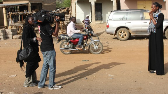 Nima Elbagir (right) and the CNN crew in Chibok, Nigeria after more than 200 schoolgirls were taken from the town.