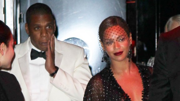 Jay Z touches his face as he leaves the Standard Hotel with his wife, Beyonce. Earlier surveillance footage from a hotel elevator showed what appeared to be Jay Z's sister-in-law first lunging at him, then swinging and kicking him, while a woman resembling Beyonce stood quietly to the side.
