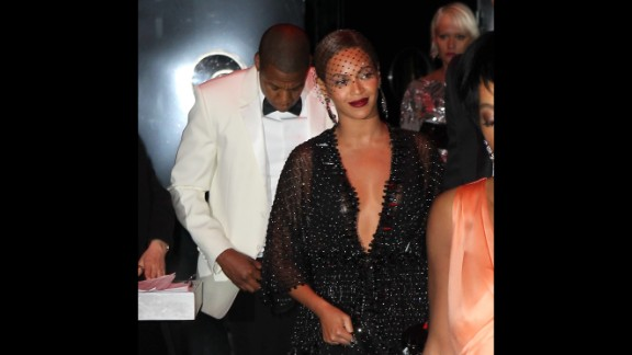 Beyonce placidly faces photographers upon leaving the party as her husband follows. In the video footage, it appeared that the man resembling Jay Z refrained from engaging in the fight.