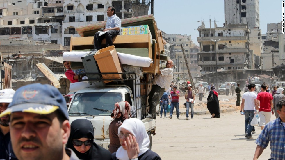 "Residents return to the Old City of Homs, Syria, on Monday, May 12, 2014. A truce between the Syrian government and rebel forces in the strategic and symbolic city <a href=""http://www.cnn.com/2014/05/07/world/meast/syria-truce-explain/index.html"">has gone into effect</a>, allowing many of its residents to come home for the first time in nearly two years. Homs has experienced some of the worst of the violence in <a href=""http://www.cnn.com/2013/08/27/world/meast/syria-civil-war-fast-facts/index.html"">a bloody civil war</a> that has left more than 100,000 people dead and driven millions of people from their homes across the country."