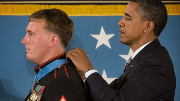 """Obama awards the Medal of Honor to Marine Sgt. Dakota Meyer in September 2011. In fighting at Gangjal, Afghanistan, on September 8, 2009,  while manning a gun truck, """"Meyer killed a number of enemy fighters with the mounted machine guns and his rifle, some at near point blank range, as he and his driver made three solo trips into the ambush area,"""" his citation said."""