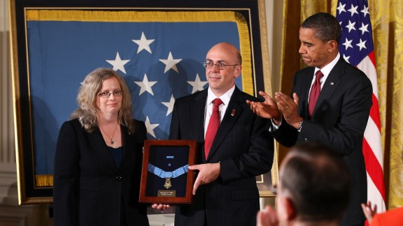 Phil and Maureen Miller receive the Medal of Honor on behalf of their son, Army Staff Sgt. Robert J. Miller, in October 2010. The soldier was cited for engaging more than 100 enemy fighters in the Gowardesh Valley, Afghanistan, on January 25, 2008. Miller killed 10 of the enemy and wounded dozens more before being mortally wounded by enemy fire.