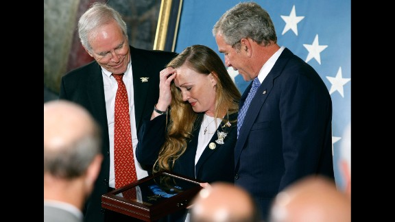 President George W. Bush presents the Medal of Honor to Daniel and Maureen Murphy, parents of Navy Lt. Michael Murphy, in October 2007. Murphy, a Navy SEAL, was killed June 28, 2005, when his four-man team was assaulted by 30 to 40 enemy fighters. Murphy exposed himself to repeated enemy fire while trying to radio for help for his besieged team, his citation said.