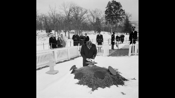 Sen. Robert Kennedy kneels by the eternal flame at the grave of his brother, President John F. Kennedy, in Arlington National Cemetery in January 1965.
