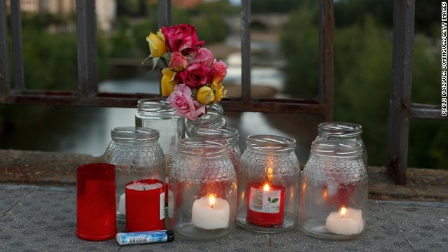 Flowers and candles lay on the bridge where Isabel Carrasco was killed on May 13, 2014 in Leon, Spain.
