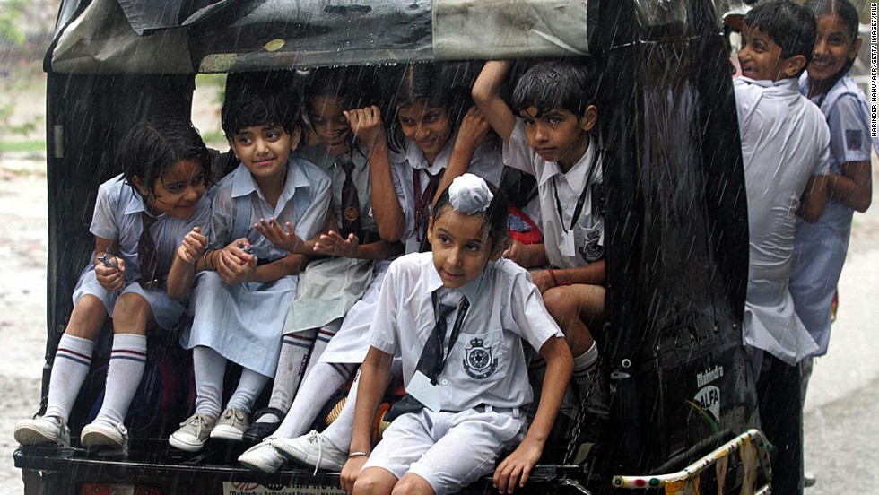Motorized rickshaws provide affordable transit for the masses, helping people get to work and functioning as a school bus for these school children in Amritsar, India.