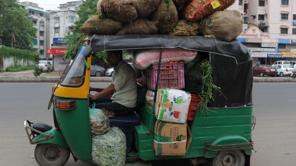 This driver wastes no space in stacking his auto rickshaw with sacks of vegetables in Ahmedabad, India.
