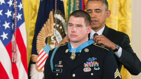 Army Sgt. Kyle White receives the Medal of Honor during a ceremony at the White House in May. He was recognized for repeatedly exposing himself to enemy fire in Afghanistan while trying to save the lives of fellow soldiers in November 2007.