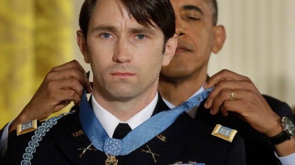 """Obama gives former Army Capt. William Swenson the Medal of Honor during a White House ceremony in October 2013. Swenson was cited for """"his exceptional leadership and stout resistance against the enemy during six hours of continuous fighting"""" in 2009, according to the Army."""