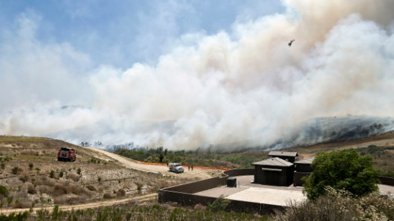Smoke rises from a canyon where a San Diego wildfire burned on May 13.