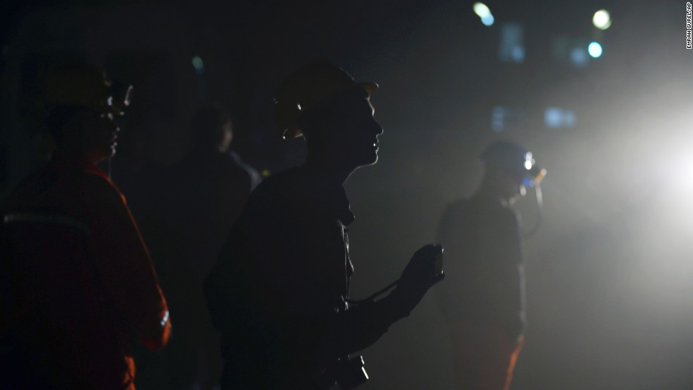 Miners wait outside the mine in the early hours of May 14.